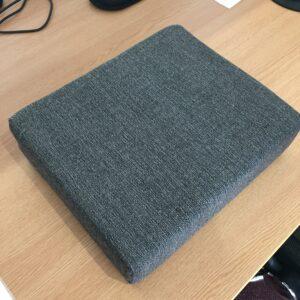 An image of a rectangular blue ProBax foam booster cushion