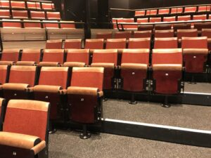image of upholstered leather fixed auditorium seating with custom rotating pedestal at the bridge theatre